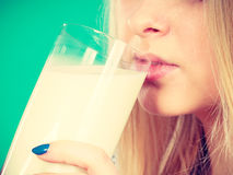 Woman drinking milk from glass Royalty Free Stock Photo