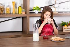 Woman drinking milk in living room royalty free stock photos