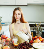 Woman  drinking milk shake with fruits Stock Photography
