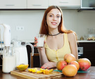Woman  drinking milk shake with mango Stock Photo