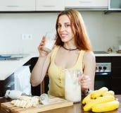 Woman drinking milkshake with bananas Stock Photos