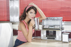 Woman Drinking Milkshake In Diner Royalty Free Stock Photo