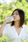 Woman drinking mineral water Stock Photo