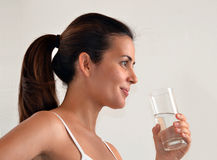 Woman drinking mineral water Stock Photography