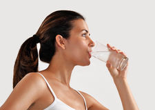 Woman drinking mineral water Royalty Free Stock Photography