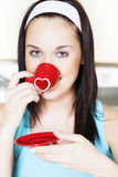 Woman drinking morning coffee - St. Valentine Day concept Stock Photo