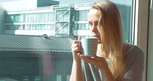 Woman Drinking Morning Tea by Window stock video