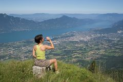 Woman drinking on mountain. Woman drinking of water to the bottle Royalty Free Stock Photos