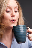 Woman drinking from mug Stock Photos