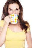 Woman drinking from a mug Royalty Free Stock Photos