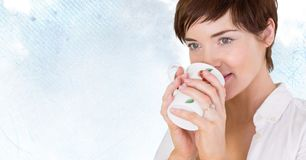 Woman drinking from mug against pale sky. Digital composite of Woman drinking from mug against pale sky Stock Photography