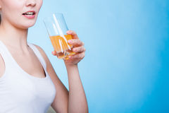 Woman drinking orange flavored drink or juice Stock Photography