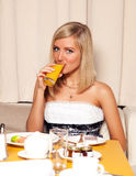Woman drinking orange juice Royalty Free Stock Image