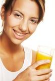 Woman drinking orange juice Stock Photo