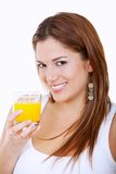 Woman drinking orange juice Royalty Free Stock Images