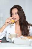 Woman drinking orange juice Stock Image