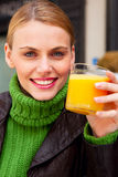 Woman drinking orange juice Royalty Free Stock Photos