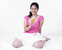Woman drinking orange juice Royalty Free Stock Photo