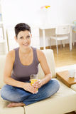 Woman drinking orange juice royalty free stock photography