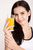 Woman drinking orange juice Beautiful mixed-race Asian, Caucasian model. Stock Images