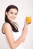 Woman drinking orange juice Beautiful mixed-race Asian, Caucasian model. Stock Image