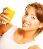 Woman drinking orange juice close up Royalty Free Stock Image