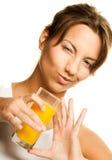 Woman drinking orange juice close up Stock Photos