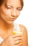 Woman drinking orange juice close up Royalty Free Stock Photo