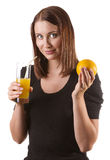 Woman drinking orange juice Royalty Free Stock Photos