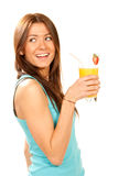 Woman drinking orange juice cocktail Stock Images