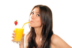 Woman drinking orange juice cocktail stock photo