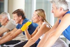 Woman drinking orange juice in gym Royalty Free Stock Photos