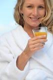 Woman drinking orange juice Royalty Free Stock Images