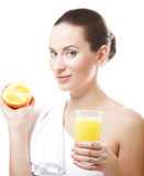 Woman drinking orange juice Stock Image