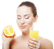 Woman drinking orange juice Stock Photos