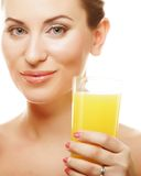 Woman drinking orange juice Stock Images