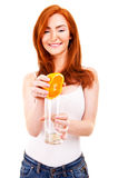 Woman drinking orange juice smiling Stock Photography