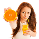 Woman drinking orange juice smiling showing oranges. Young beaut Royalty Free Stock Photography