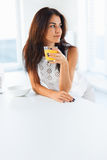 Woman drinking orange juice smiling. Stock Photography