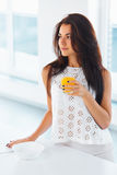 Woman drinking orange juice smiling. Royalty Free Stock Photography