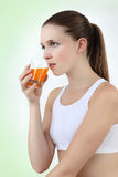Woman drinking orange juice vitamin Royalty Free Stock Image