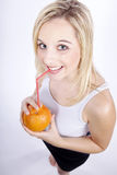 Woman drinking an orange with straw Royalty Free Stock Photo