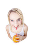 Woman drinking an orange with straw Stock Photo