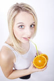 Woman drinking an orange with straw Stock Photography