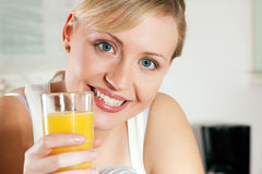Woman drinking orangejuice Royalty Free Stock Photo