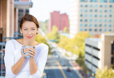 Woman drinking on outside balcony Stock Images