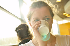 Woman is drinking from paper cup Stock Photo