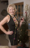 Woman drinking at a party. Elderly female party hostess with a glsss of wine royalty free stock photo