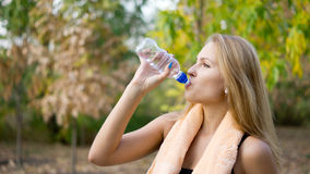 Woman drinking pure bottled water Stock Photos