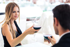 Woman drinking red wine with boyfriend Stock Photography